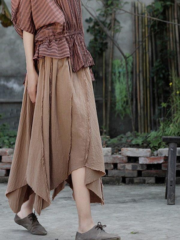 Длинная, асимметричная юбка с карманами