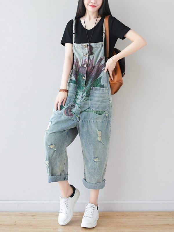 Светлый джинсовый комбинезон с цветочным принтом